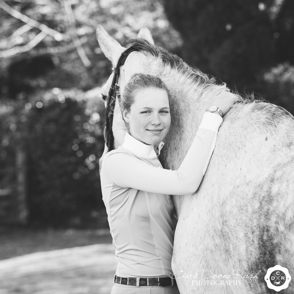 A portrait of a girl and her horse
