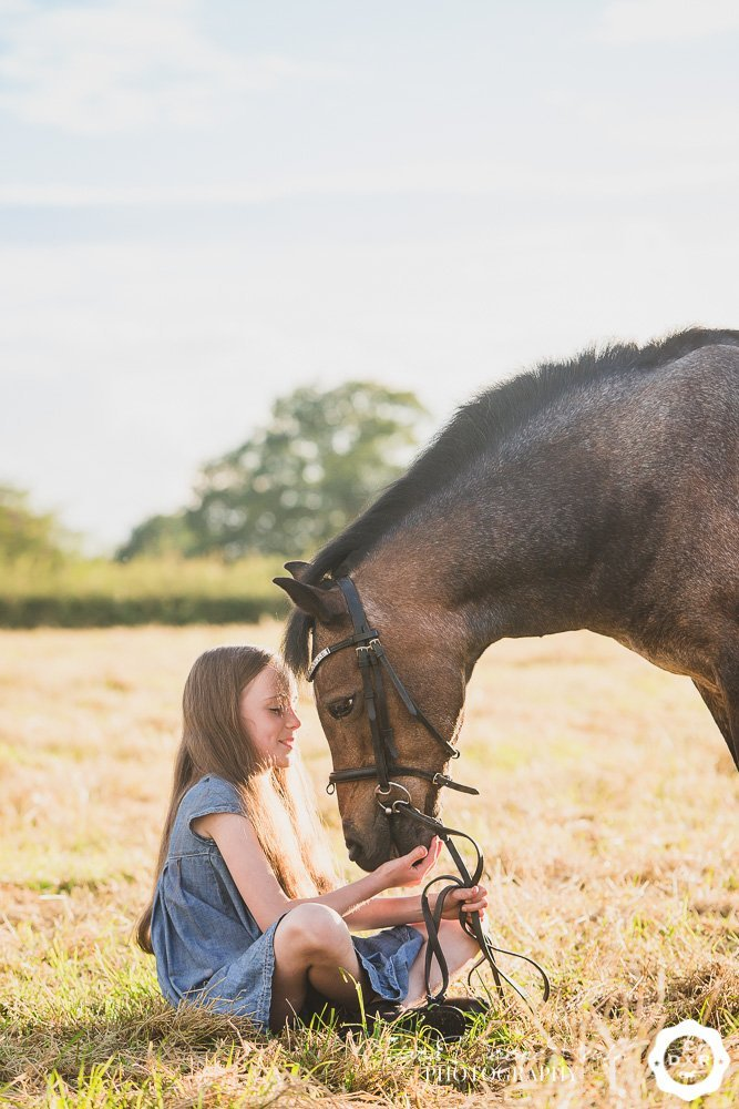 photo shoot of a girl and her pony