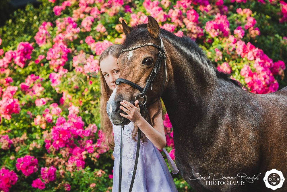 a girl and her pony by roses