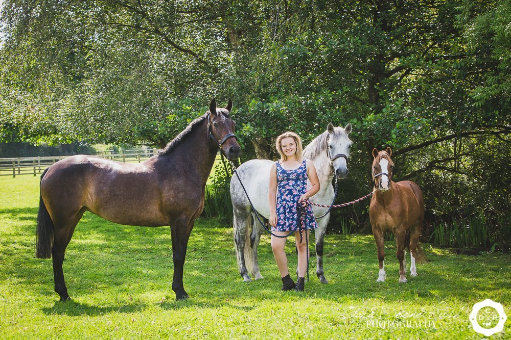 caitlin on a photo shoot with her three show ponies
