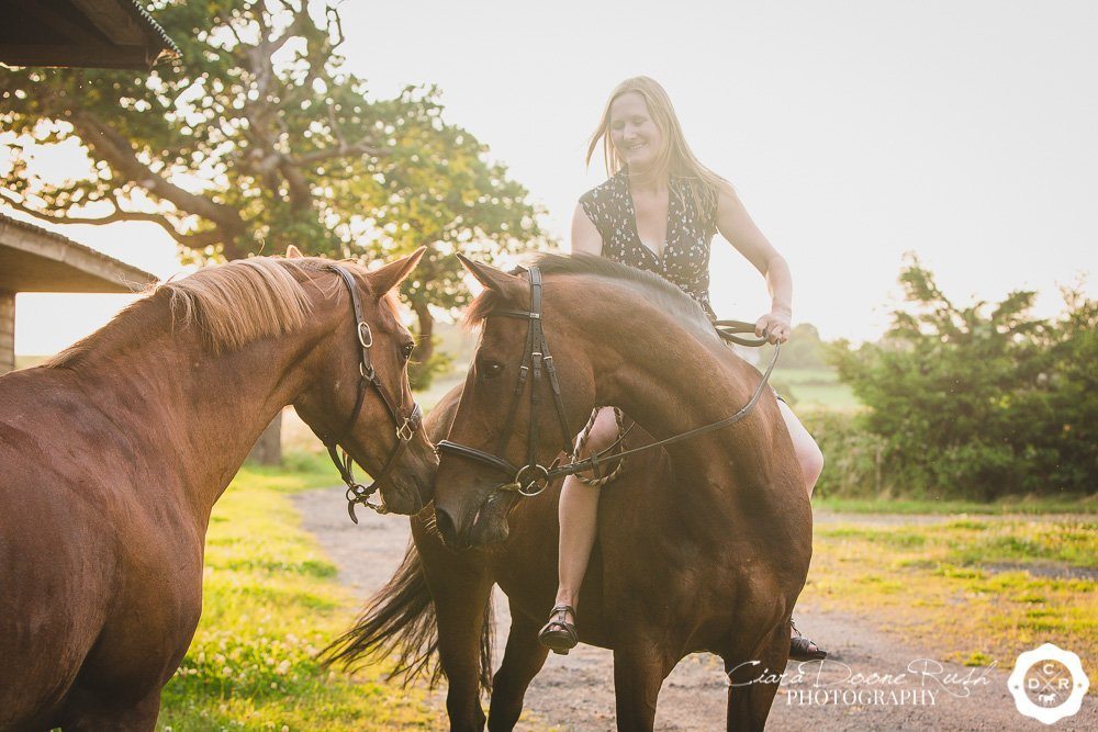 a woman and her two horses
