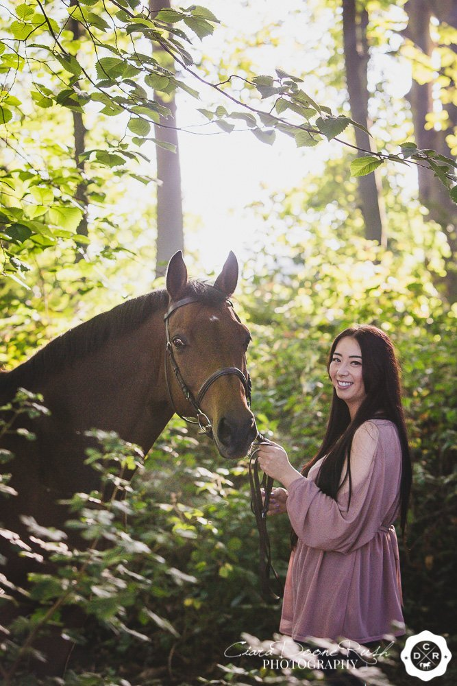 horse and rider in the woods