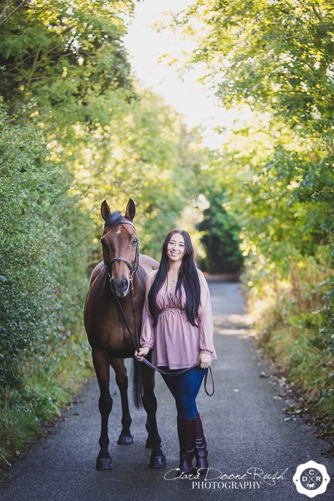 a horse and rider on a lane in knowsley