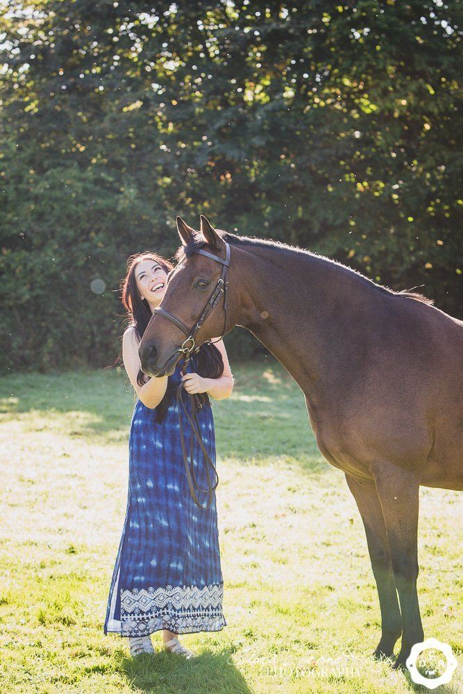 a woman and her horse in a field