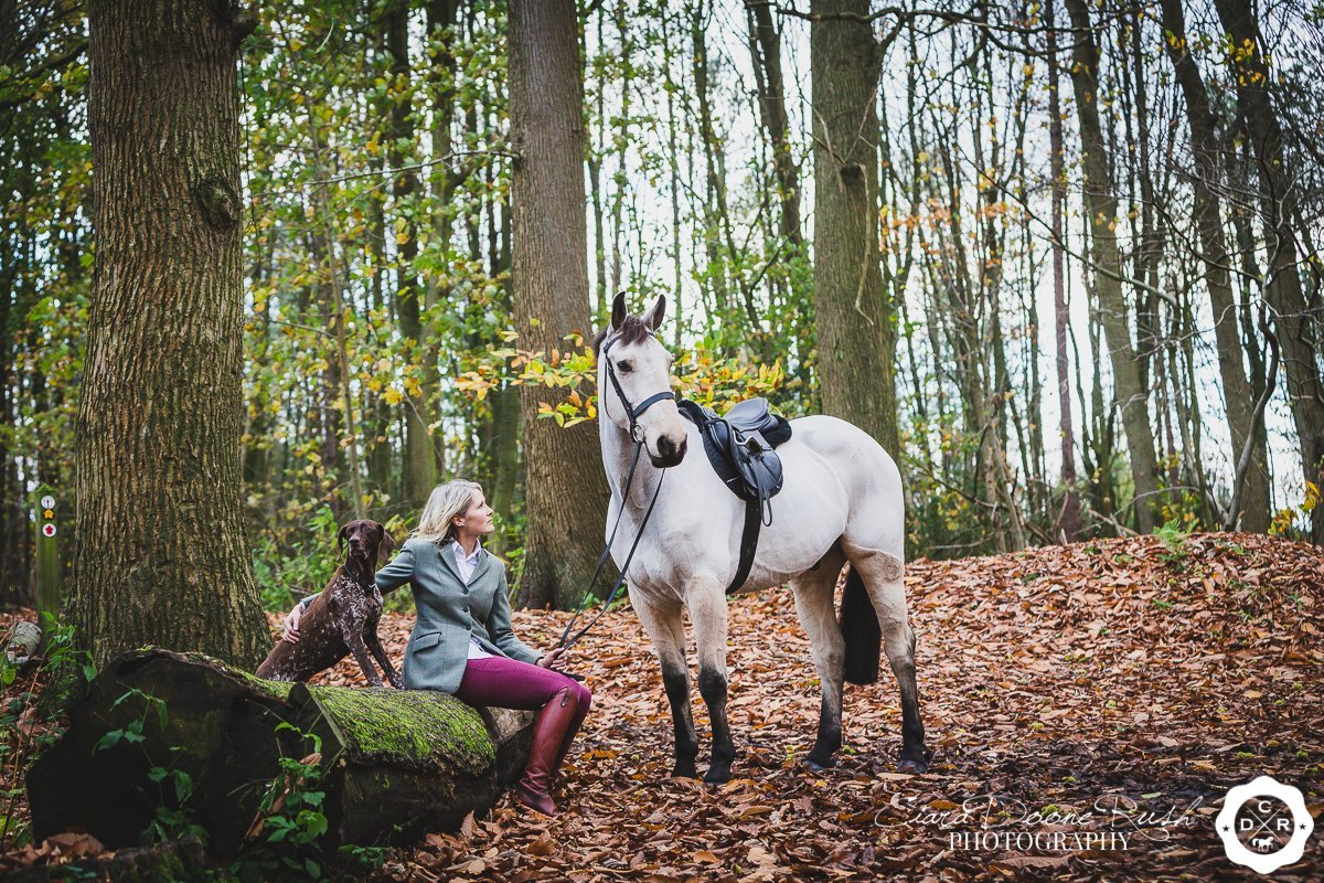 a woman and her dun horse on a photo shoot in delamere forest