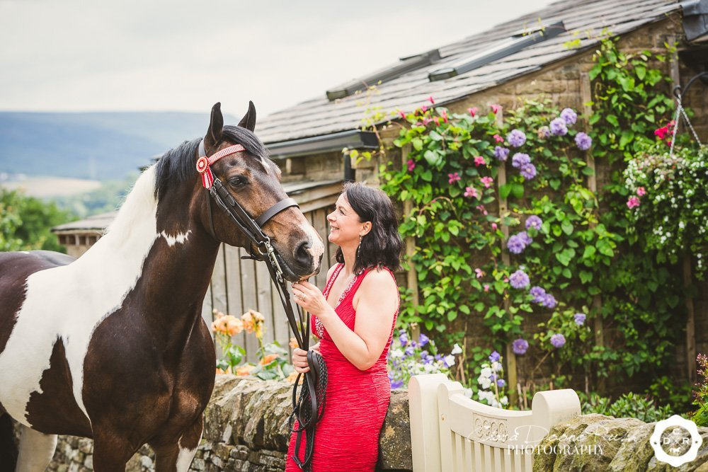 A glamorous woman and her horse