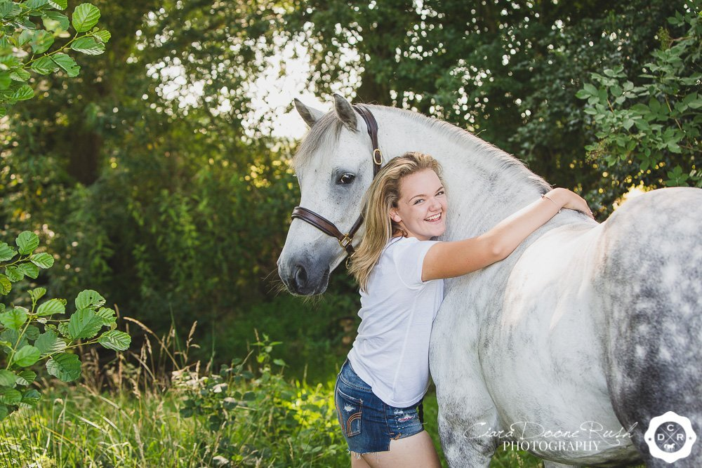 a summertime photo shoot of a teenager and her pony