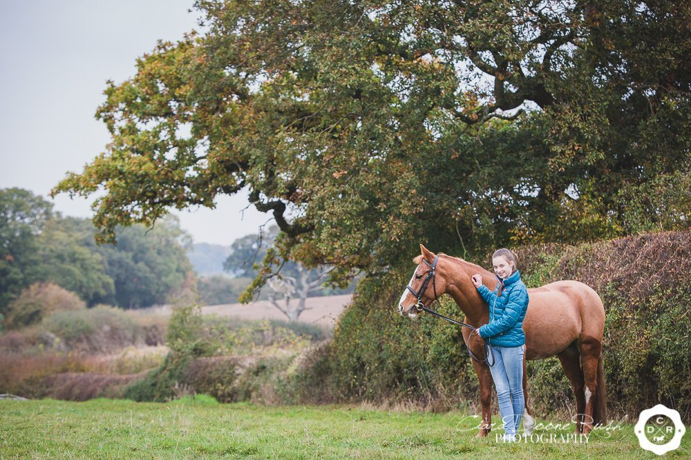 a winter horse and rider photo shoot