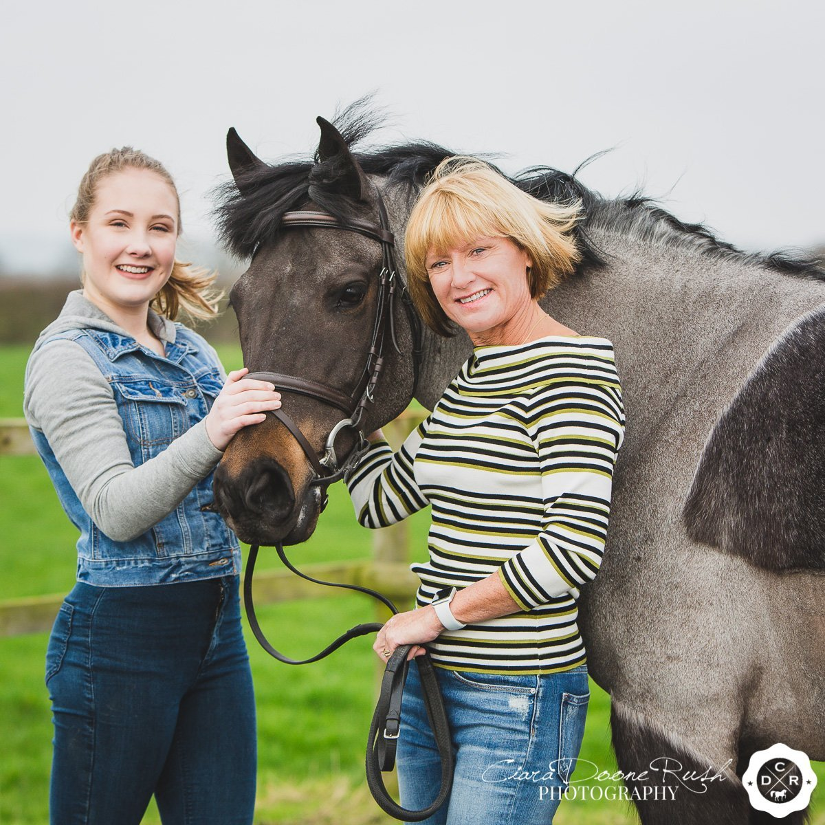 Mother and daughter with pony