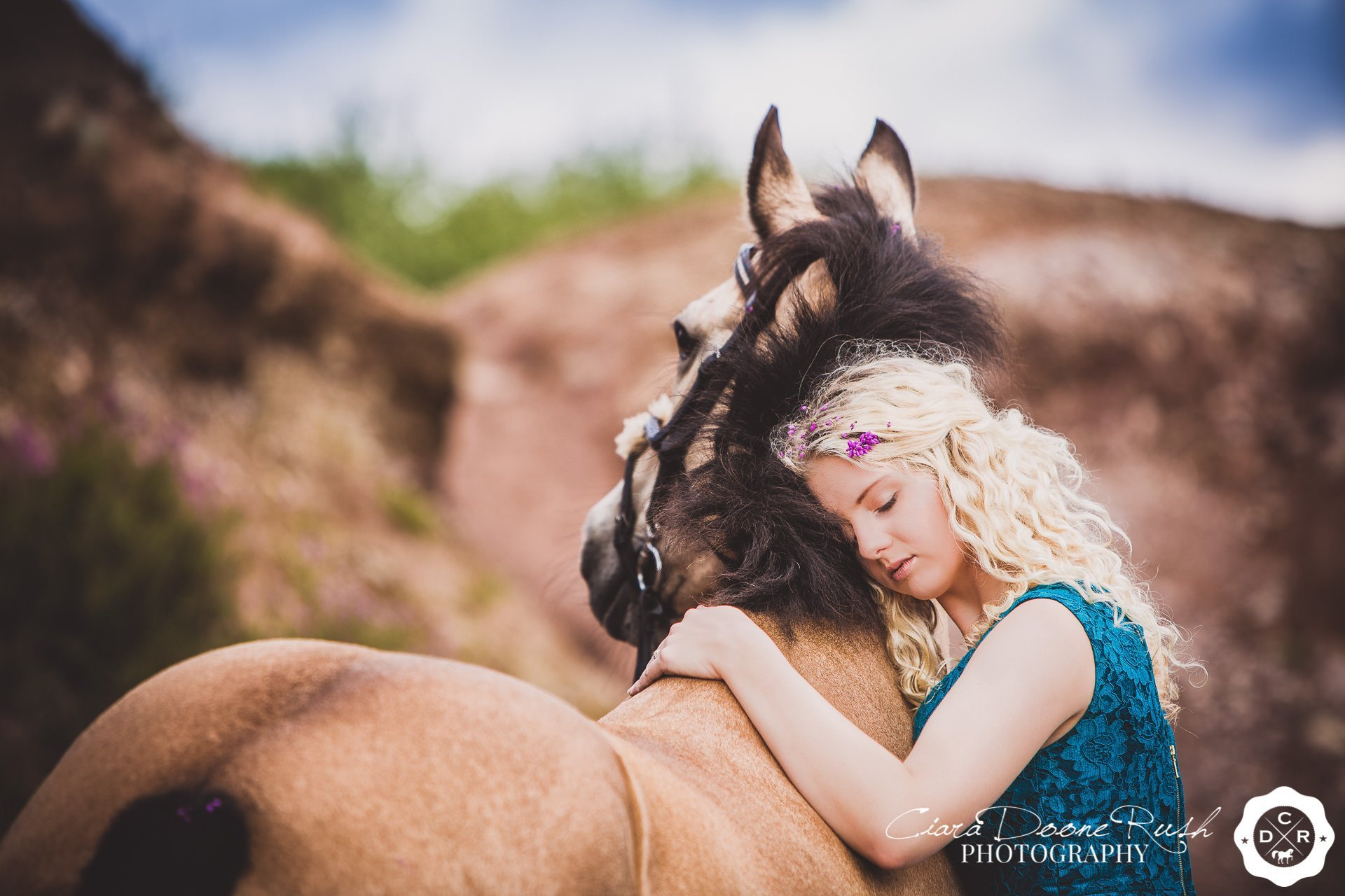A girl and her pony on a mud to make up horse and rider photo shoot