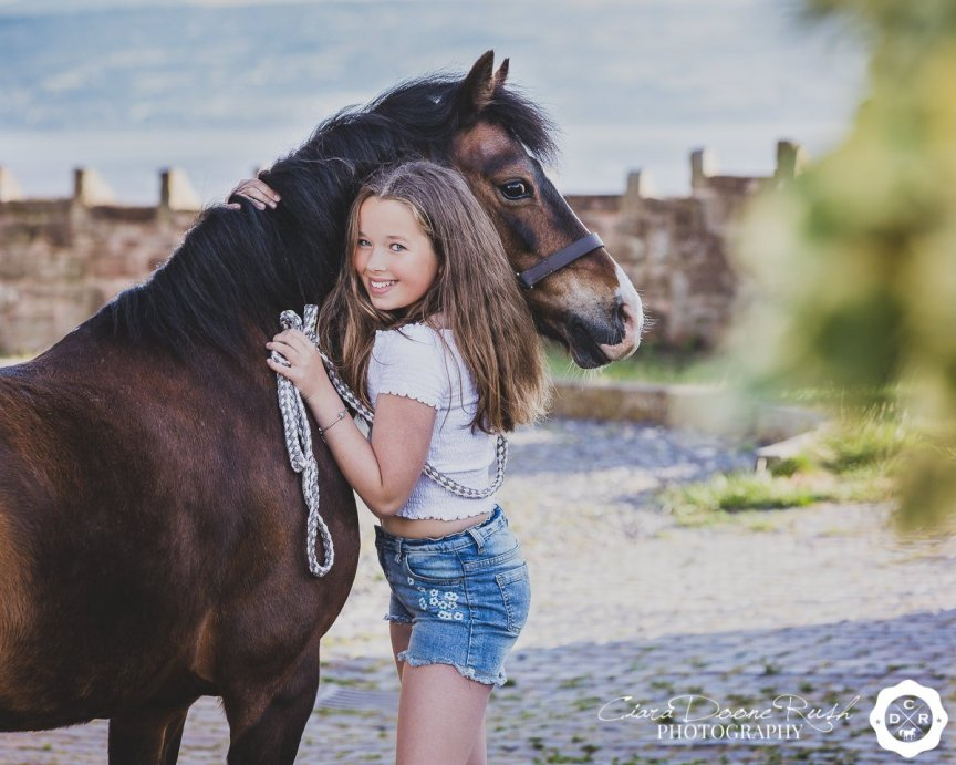 a little girl and her pony on a photo shoot on the wirral