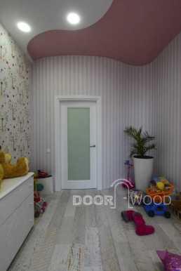 Радиусная дверь в детской комнате.