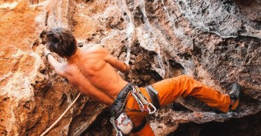 Rebellious rock climber on the wall
