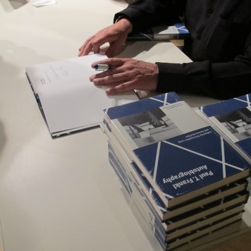 Editor and design scholar Christopher Long signs copies of his latest title, Paul T. Frankl   Autobiography at a book signing event in Santa Monica, CA.
