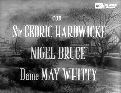 Fotogramma dei titoli di testa in italiano del film Il sospetto, leggono con Sir CEDRIC HARDWICKE, NIGEL BRUCE, Dame MAY WHITTY