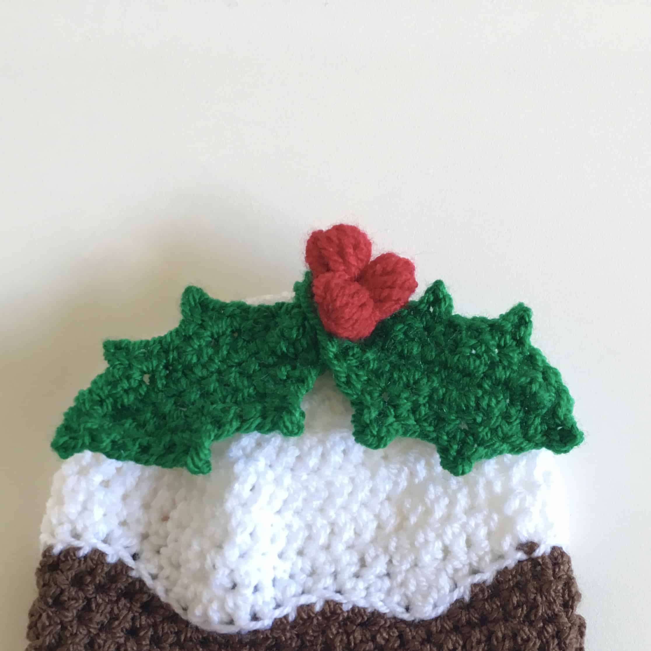 crochet christmas pudding hat with holly and berries