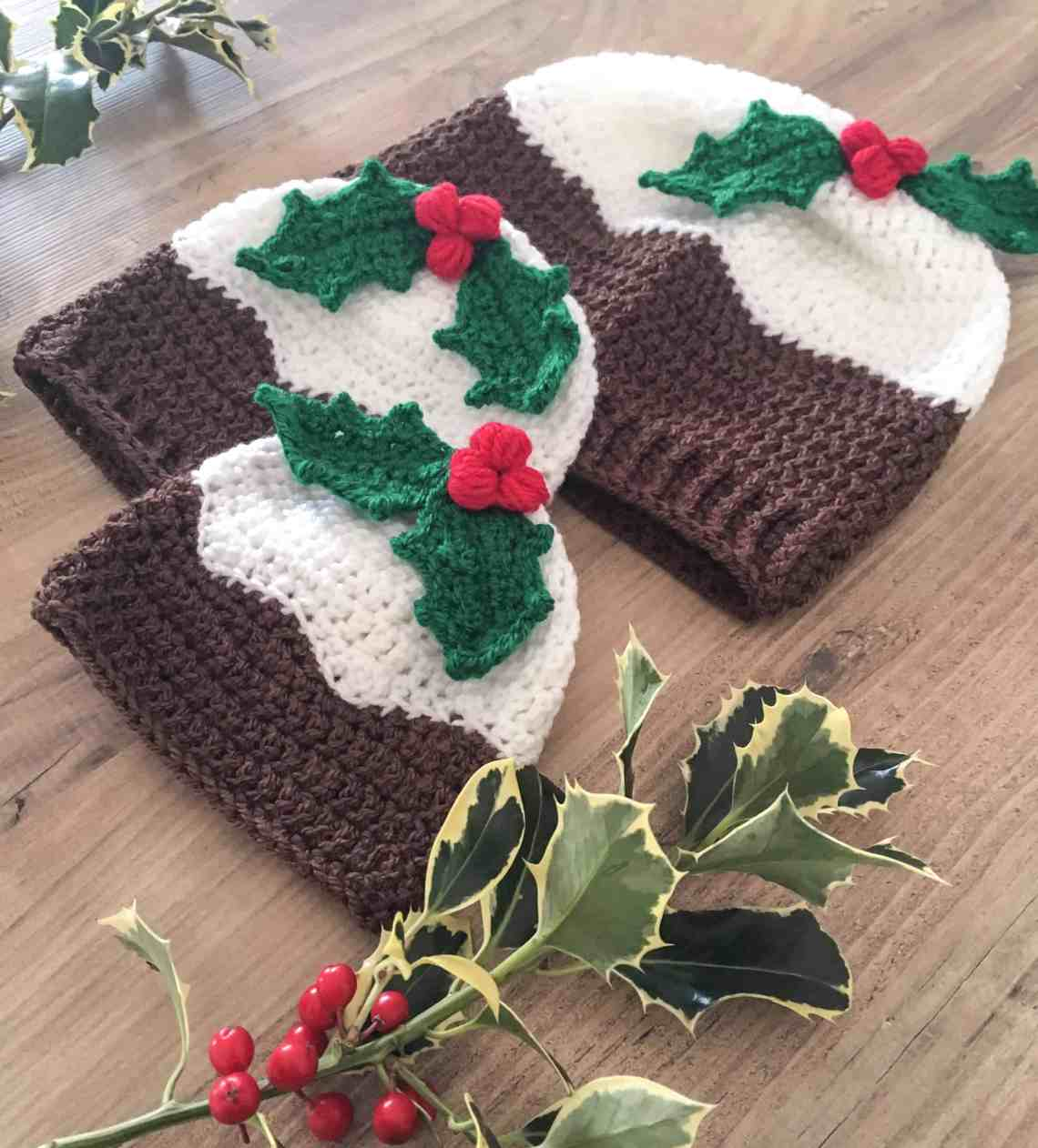 Dora's crochet christmas pudding hat with holly leaves and berries in multiple sizes