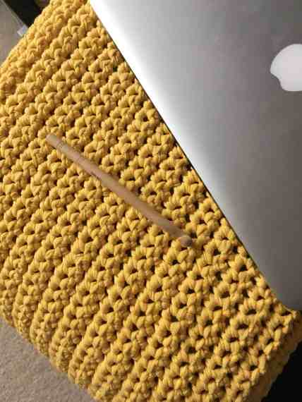 crochet footstool cover with laptop and hook