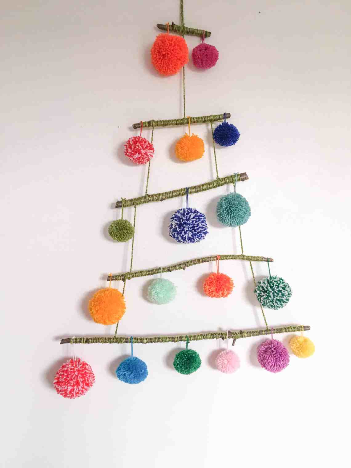 pom-pom alternative christmas tree craft project with colourful yarn