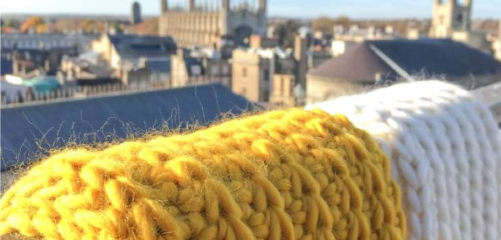 crochet infinity scarf with cambridge uk in back drop