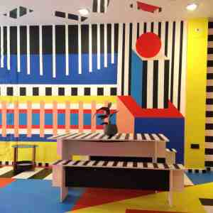 art installation bright colours stripes and spots cafe