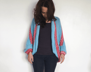 crochet striped red pink and blue shrug