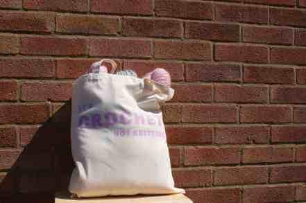 It's crochet not knitting project bag with yarn purple on cream