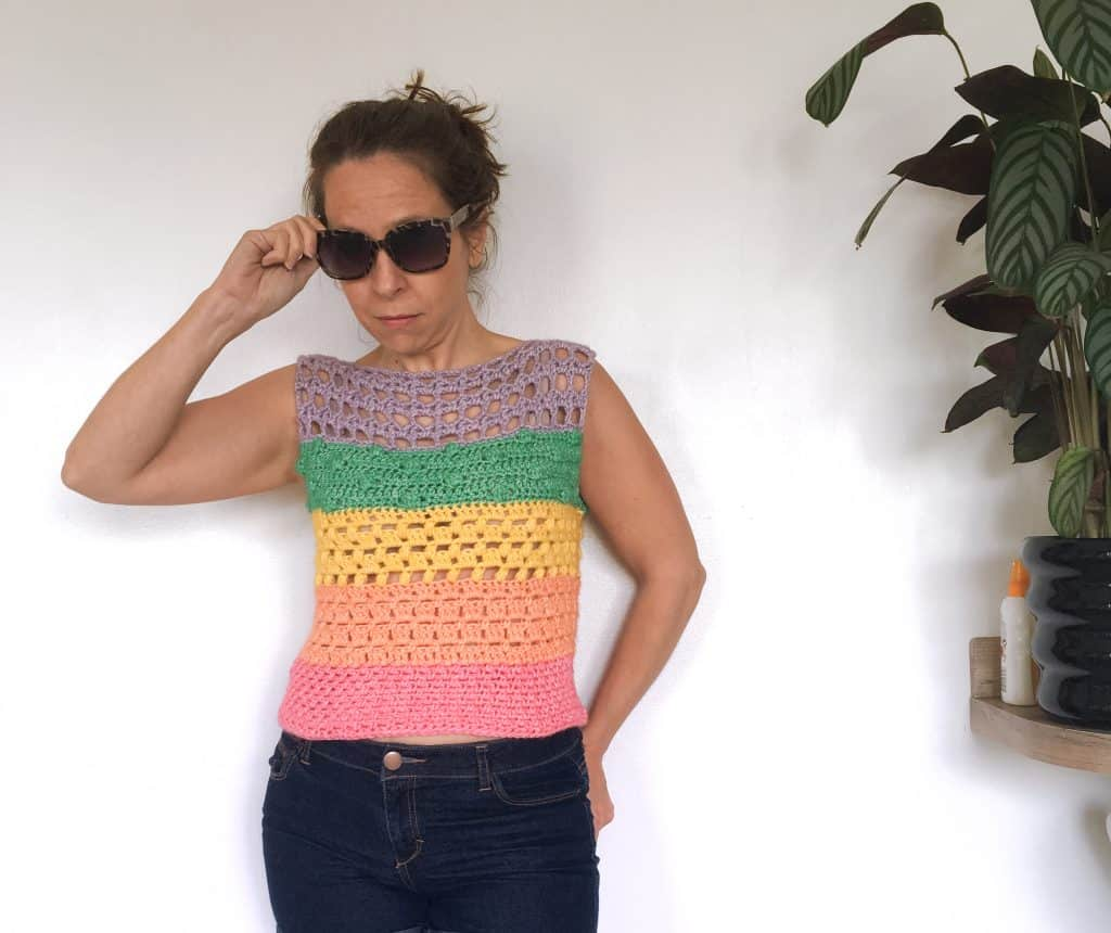 Woman in sunglasses and rainbow cotton crochet top