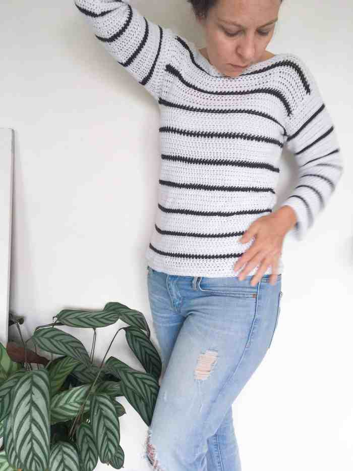 crocheted white sweater with black stripes