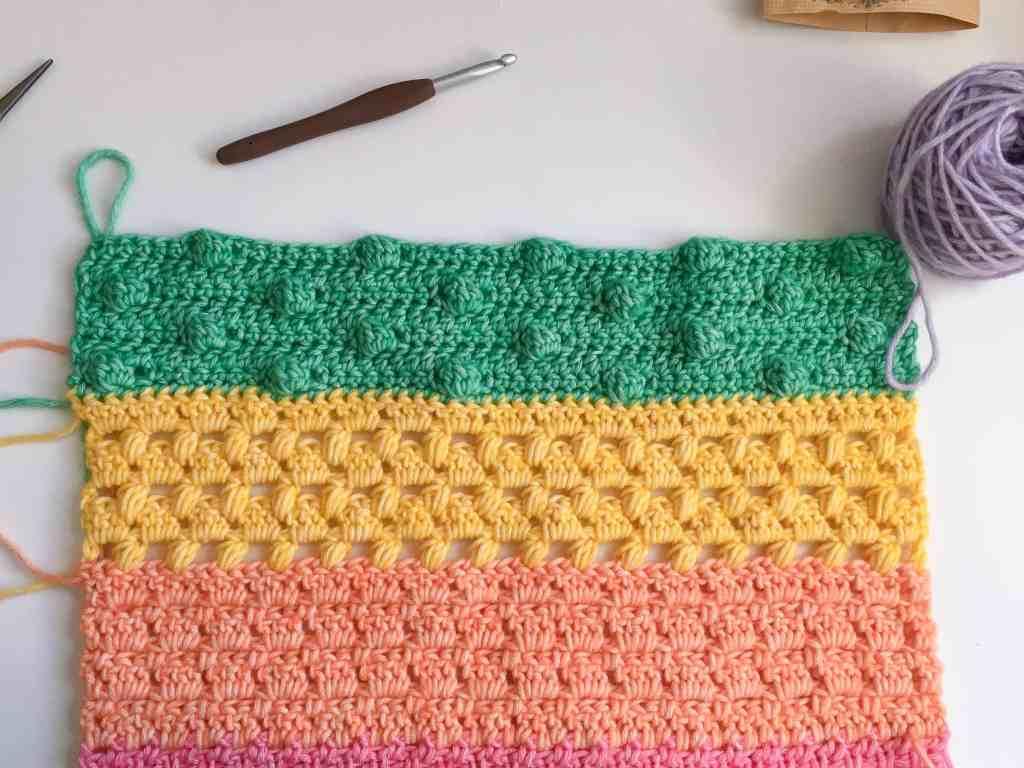 crochet cluster stitch on rainbow crochet fabric