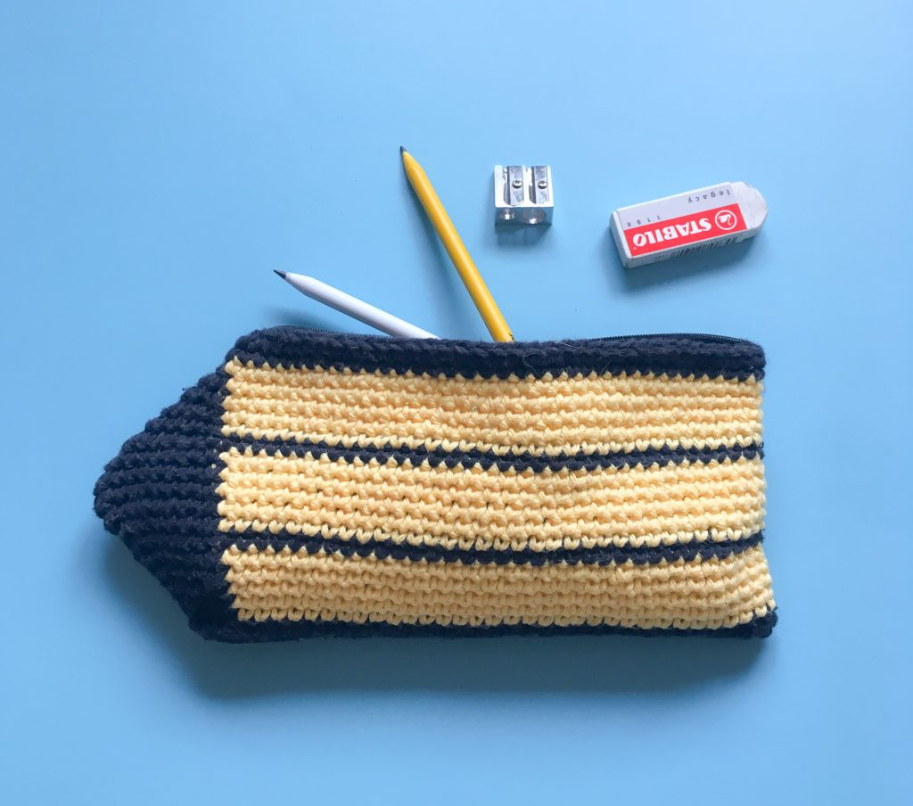 crochet yellow and black stripy pencil case with pencils rubber sharpner