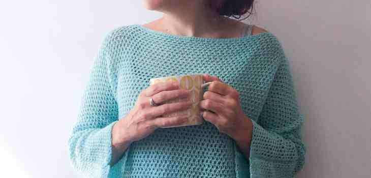 Woman in turquoise crochet sweater