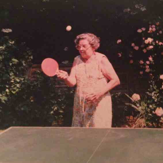 old lady playing ping pong in the 80s