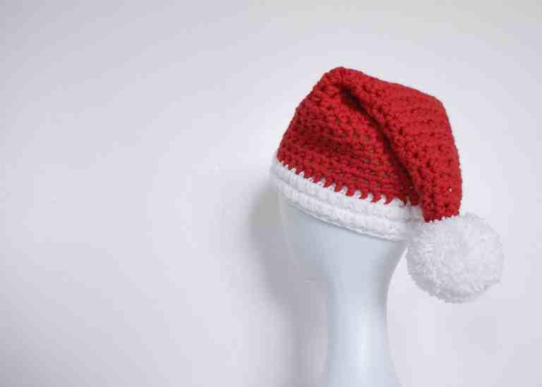 Crochet santa hat on mannequin