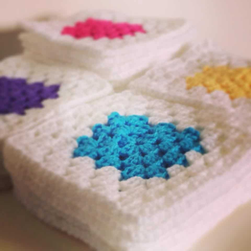 Crochet Squares piled up ready to make a blanket