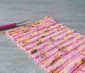 Crochet hook and gauge swatch in pink leopard print