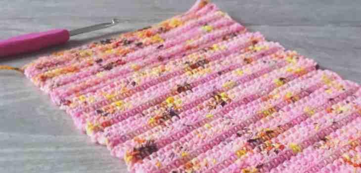 Crochet hook and gauge swatch in pink leopard print