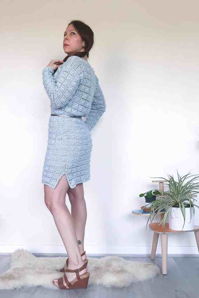 Women in retro crochet dress with bunches