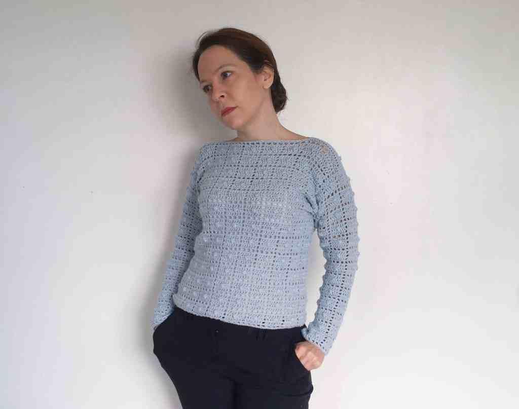 Woman in geometric blue crochet sweater