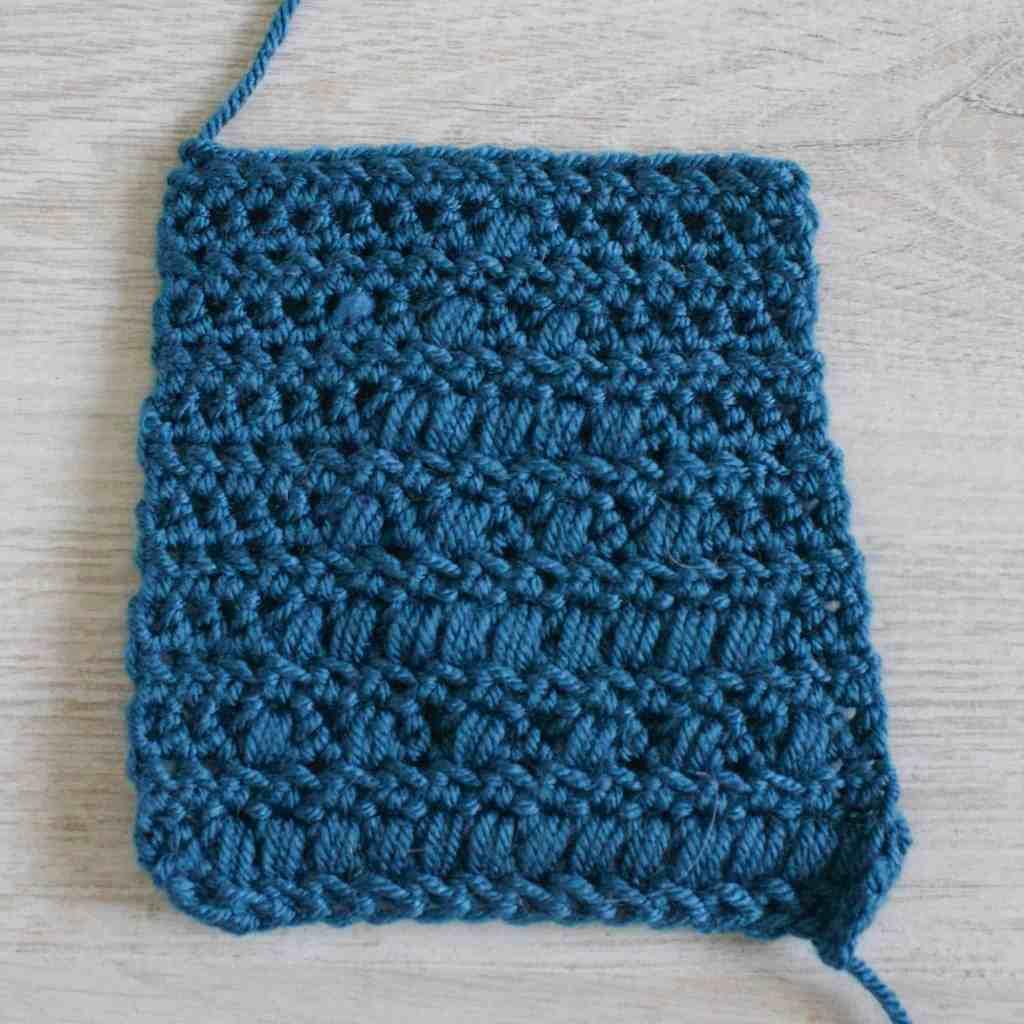 Back of a blue crochet bobble stitch swatch