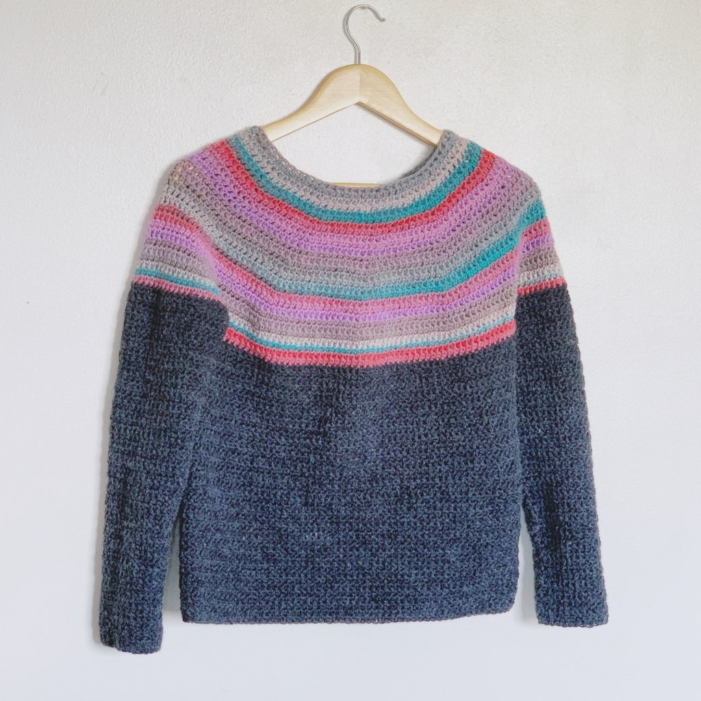 Round yoke crochet sweater made in double knit with colourful yoke and charcoal body