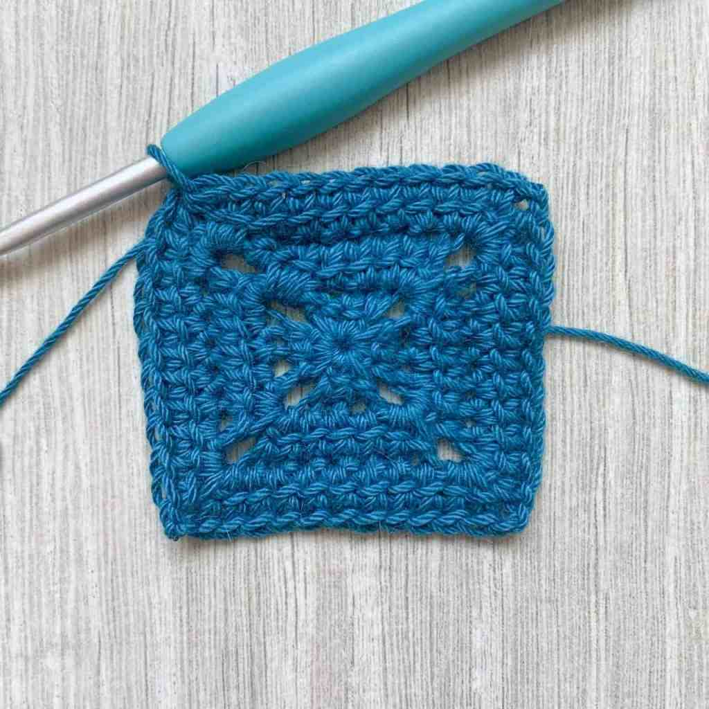 an image of a 3 round blue crochet solid linked granny square