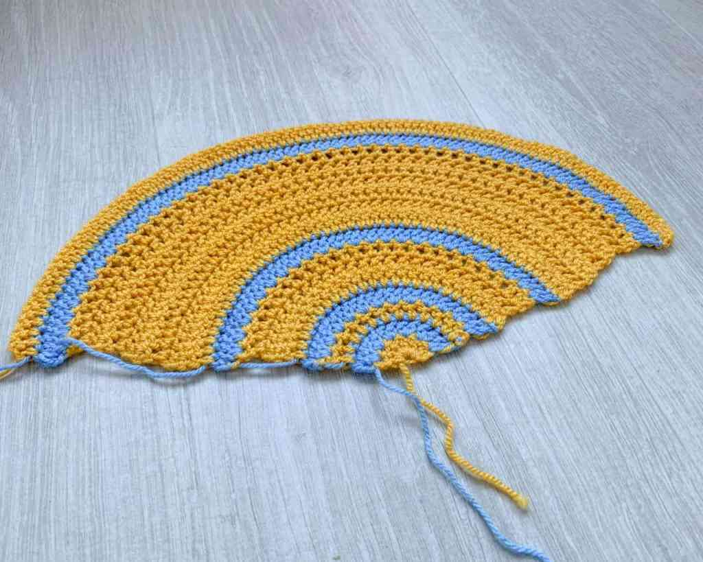 Mustard and blue pi shawl swatch Reading about a third of a circle segment
