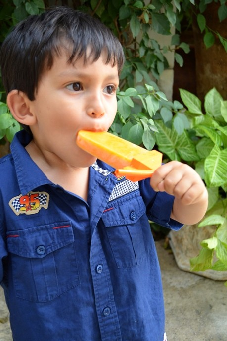 This recipe for mango chile paletas or paletas de mango con chile, combines mango, lime juice and chile powder for a sweet and spicy treat.