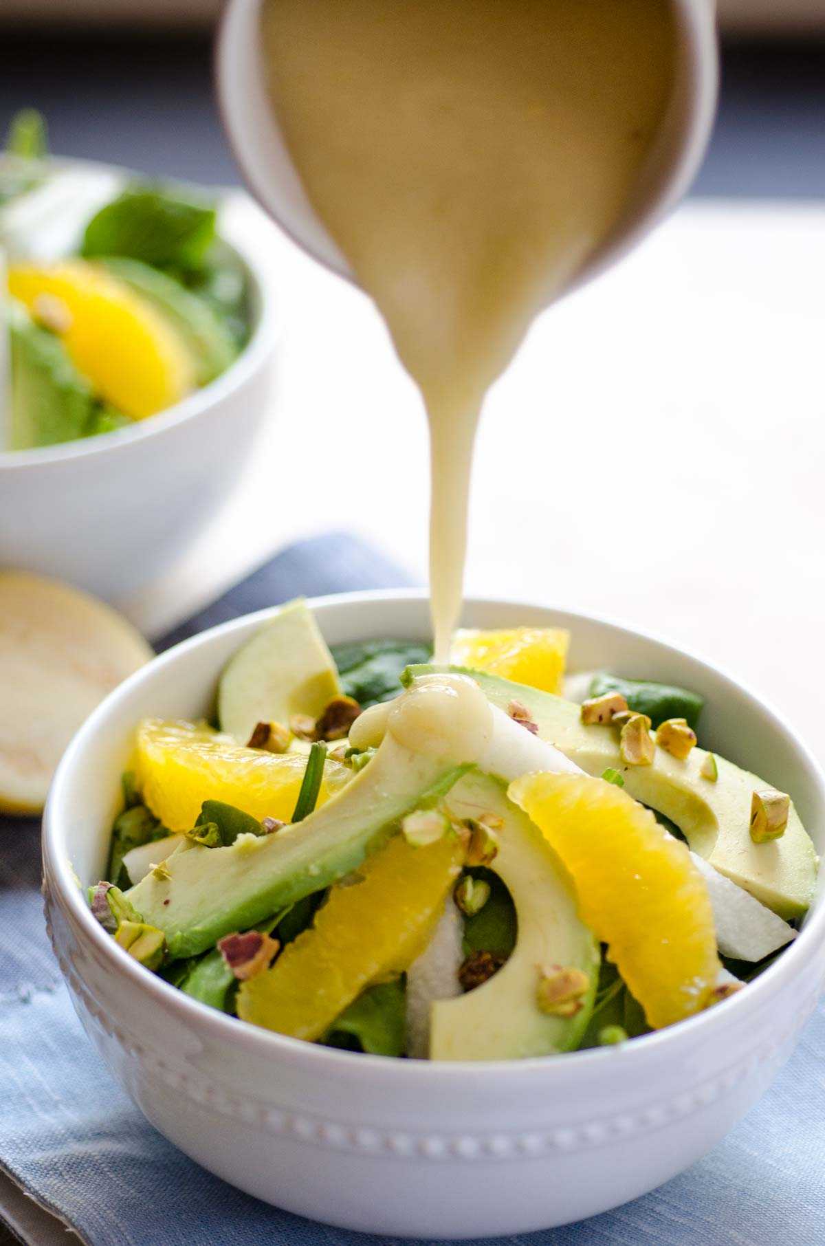 This Spinach Avocado Jicama Salad combines baby spinach, creamy avocado, jicama, orange, and pistachios tossed with a guava dressing.