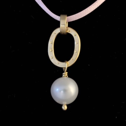 pendant with a pearl dangling beneath a flat gold circle