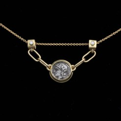 gold pendant with ancient coin and diamonds