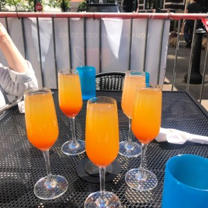 Drink glasses with orange colored drink