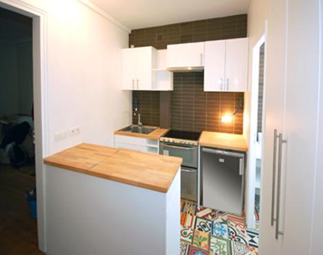 clever kitchen cabinet hides full-size washing machine