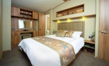 KING SIZE MASTER BEDROOM WITH WALK IN WARDROBE AND EN-SUITE SHOWER ROOM